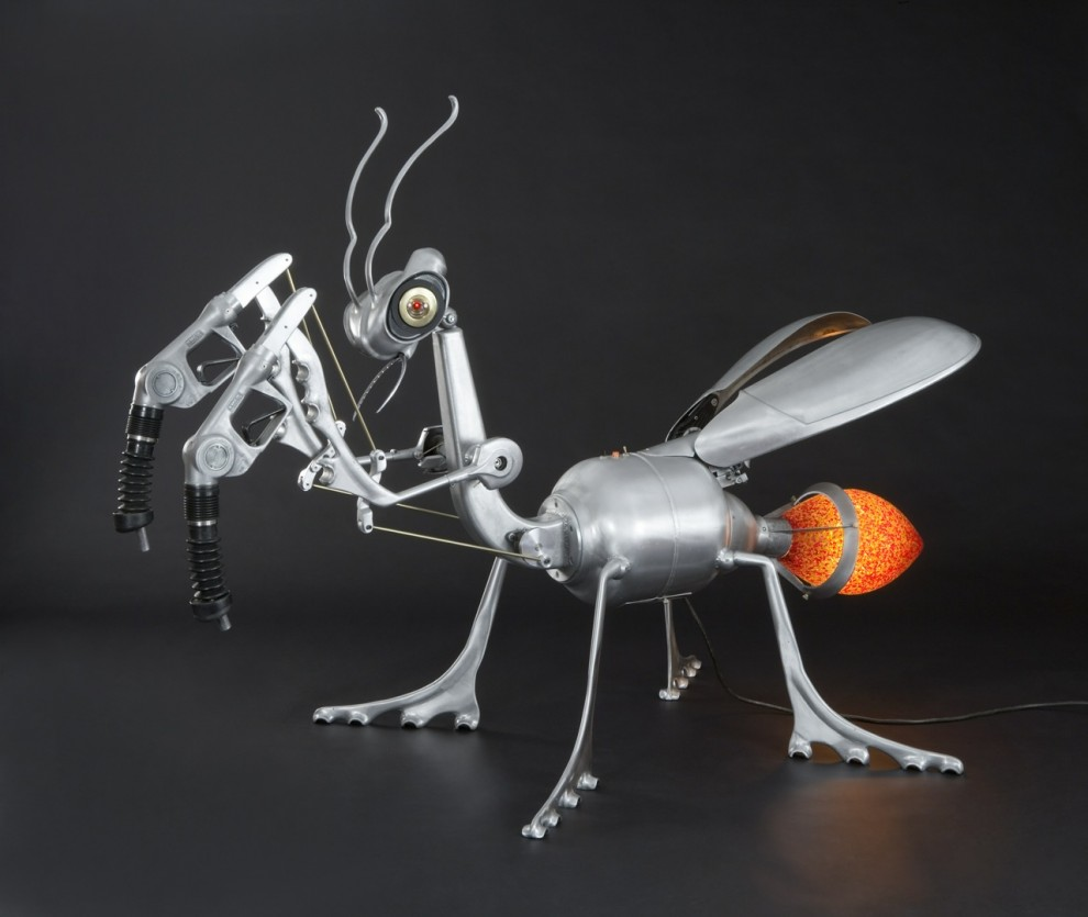 Kinetic Sculpture of Praying Mantis made from found materials.