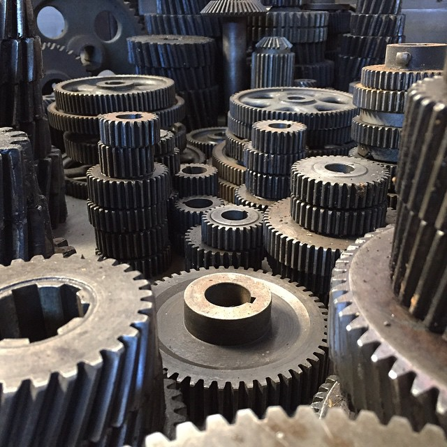 I was gifted an awesome set of old lathe gears today. Seeing them all laid out like this has me thinking of using them for a miniature film set.